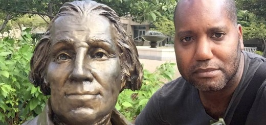 A selfie picture taken with a statue of George Washington in Kogan Plaza at GWU